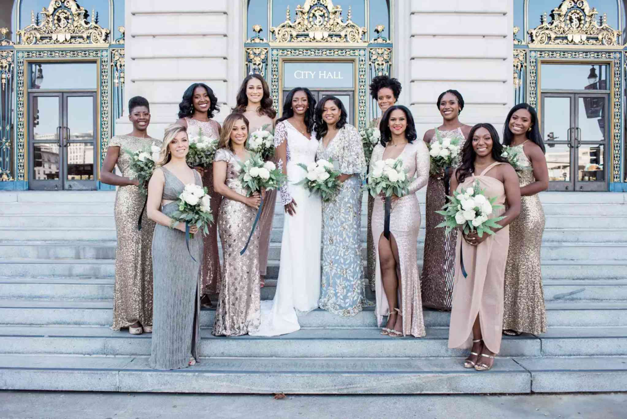 Bride with bridesmaids in mismatched sequin dresses