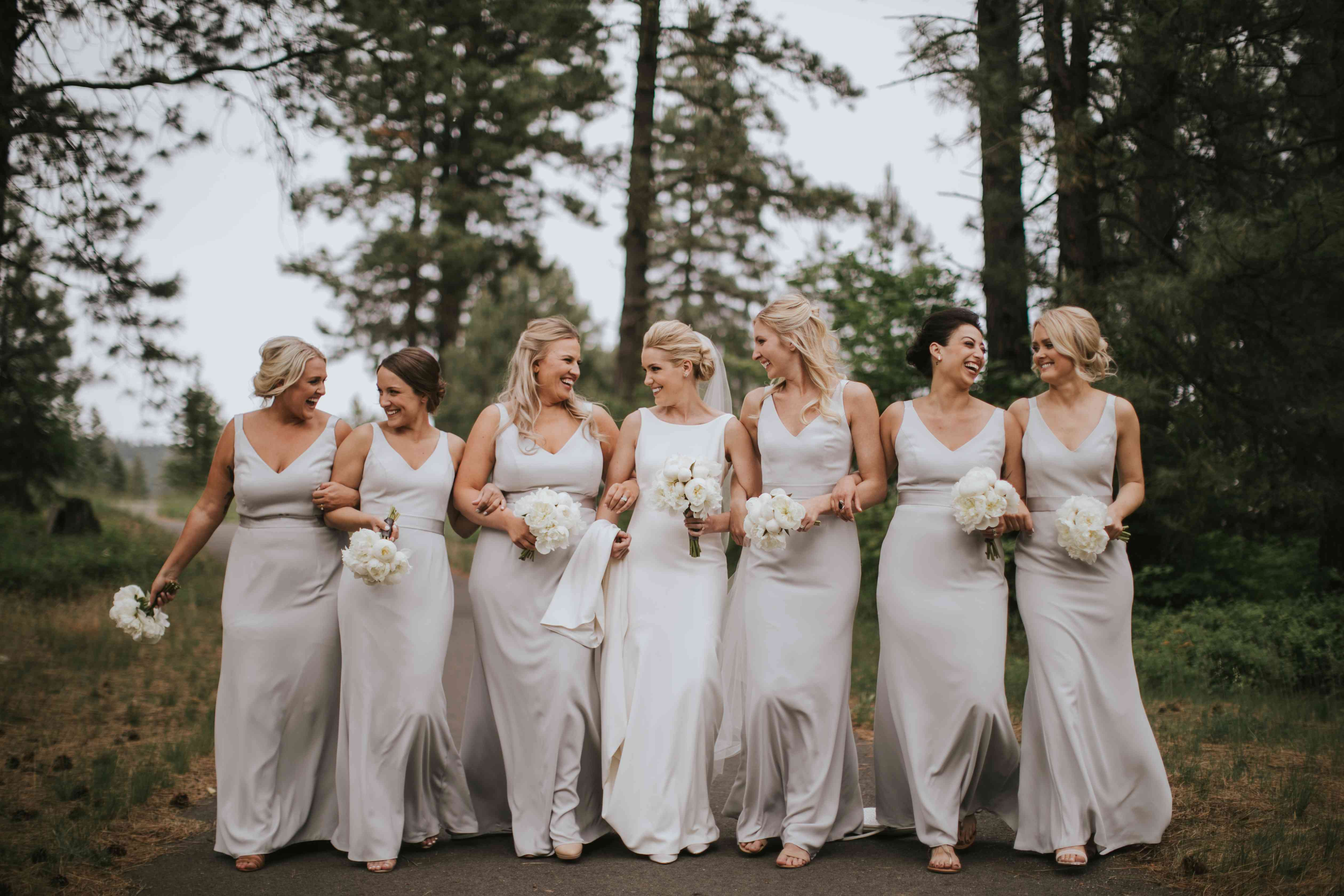 Bride with bridesmaids in grey gowns