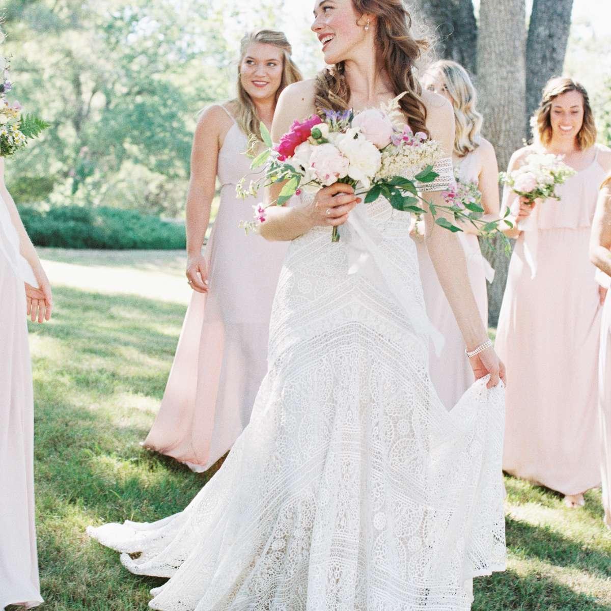 bride wedding dress with bridesmaids