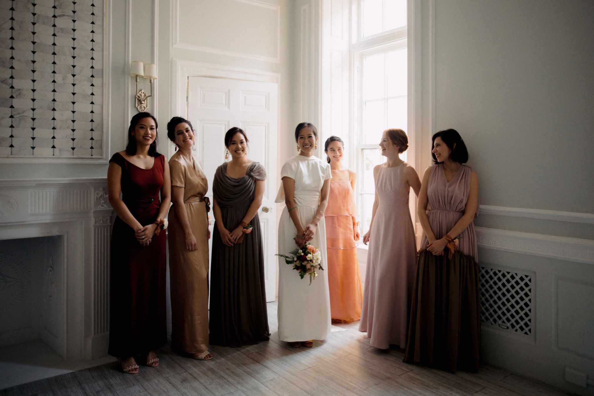 Bride with bridesmaids in smokey neutrals