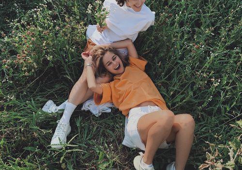 two friends in a field