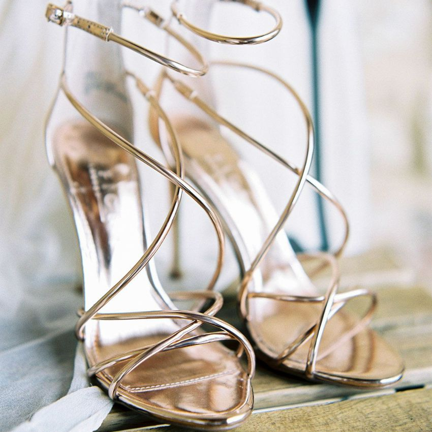 Pair of strappy rose gold wedding shoes