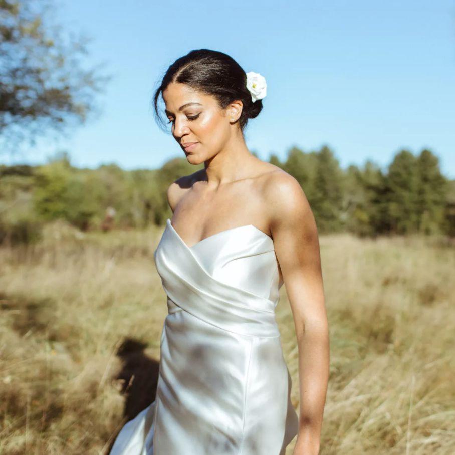Bride with single white bloom in chignon