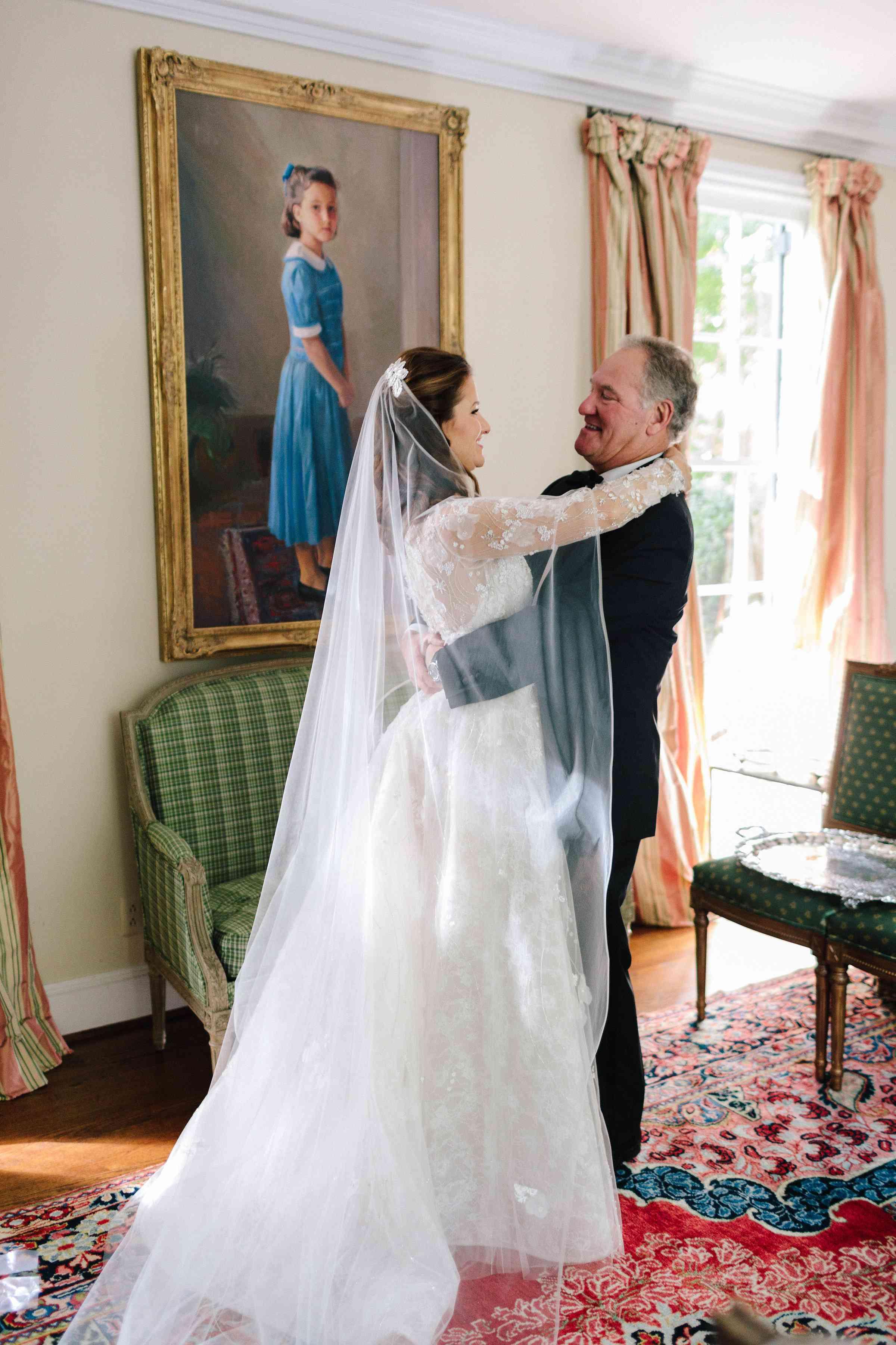 Bride in front of portrait