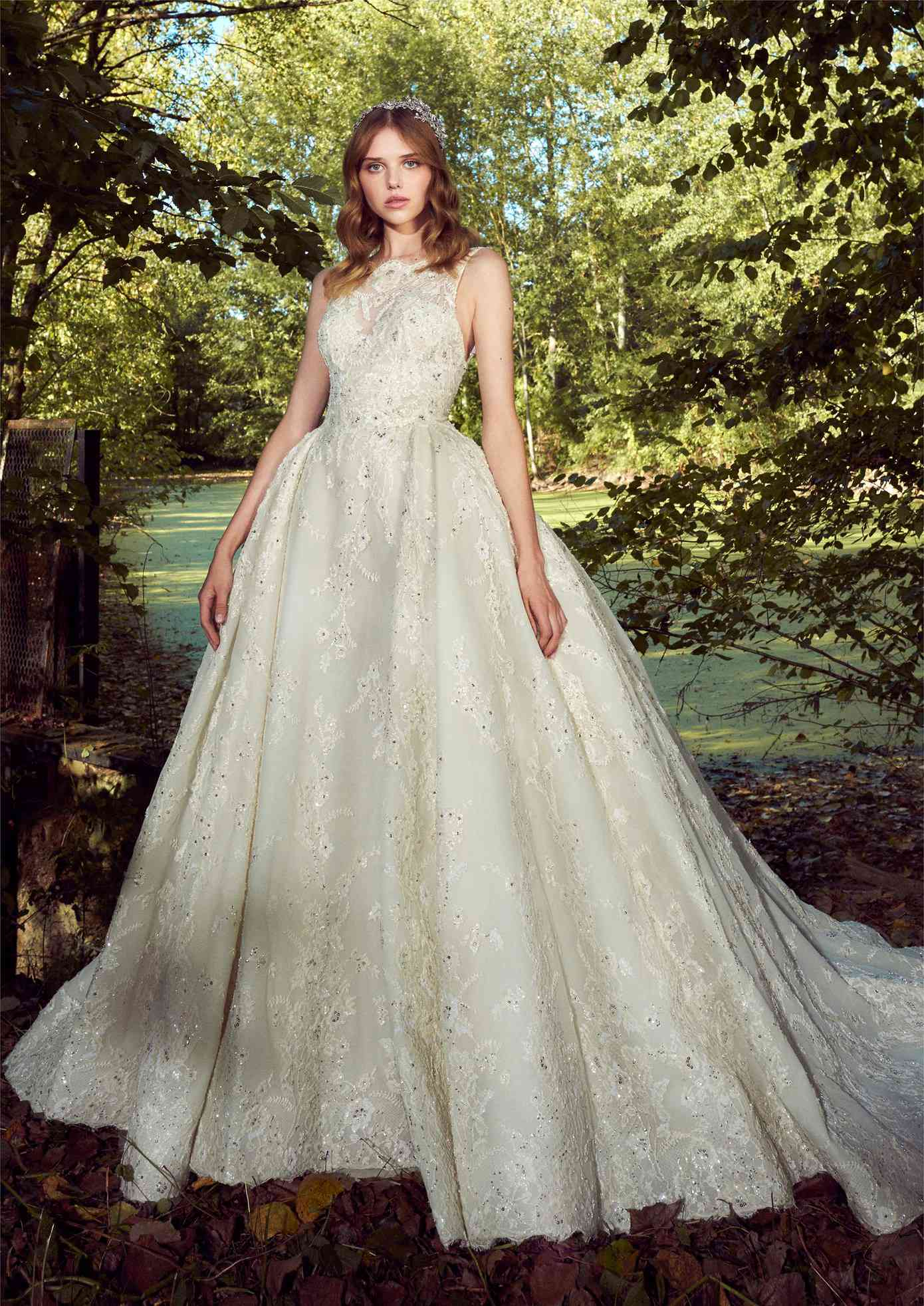 Model in off-white high-neck sleeveless ballgown with allover sequined floral lace embroidery