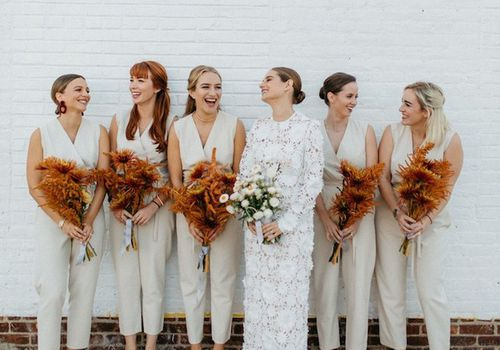 Bridesmaids and bride holding bouquets of flowers