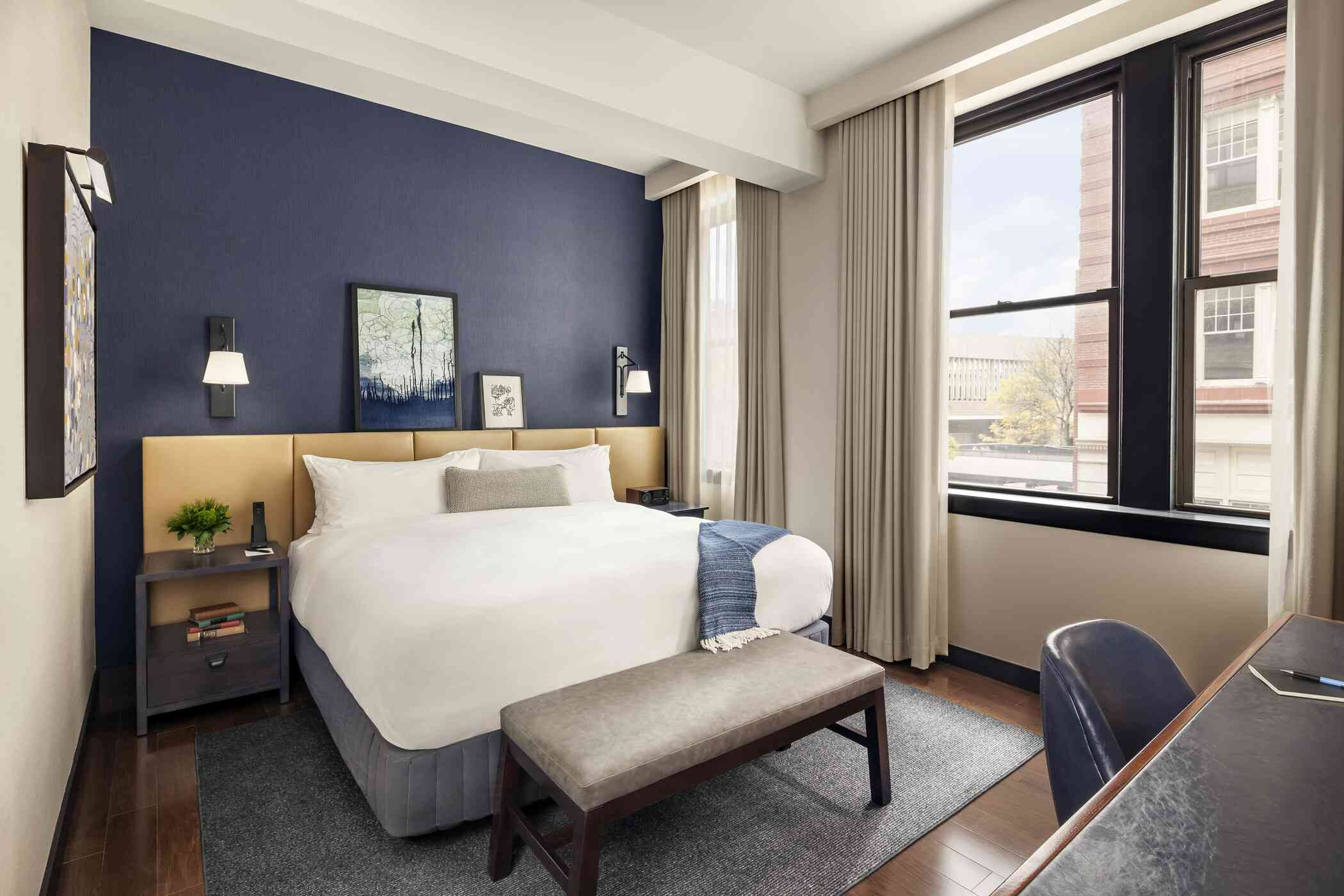 Hotel room with grey-blue color scheme