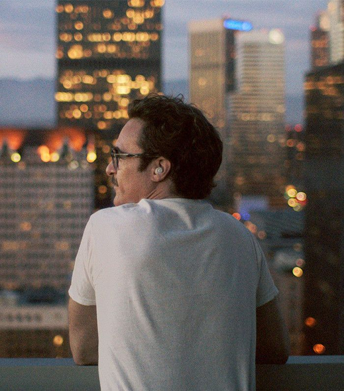 Joaquin Phoenix looking out at the L.A. skyscrapers in Her