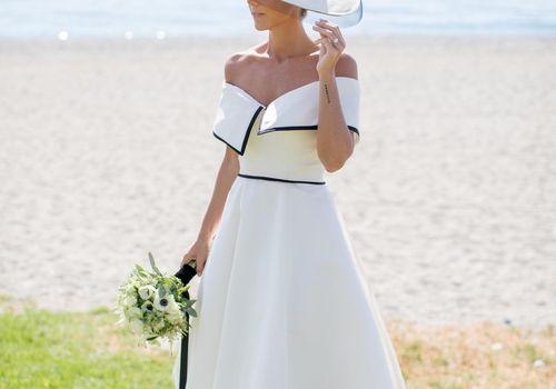 <p>bride in hat</p>