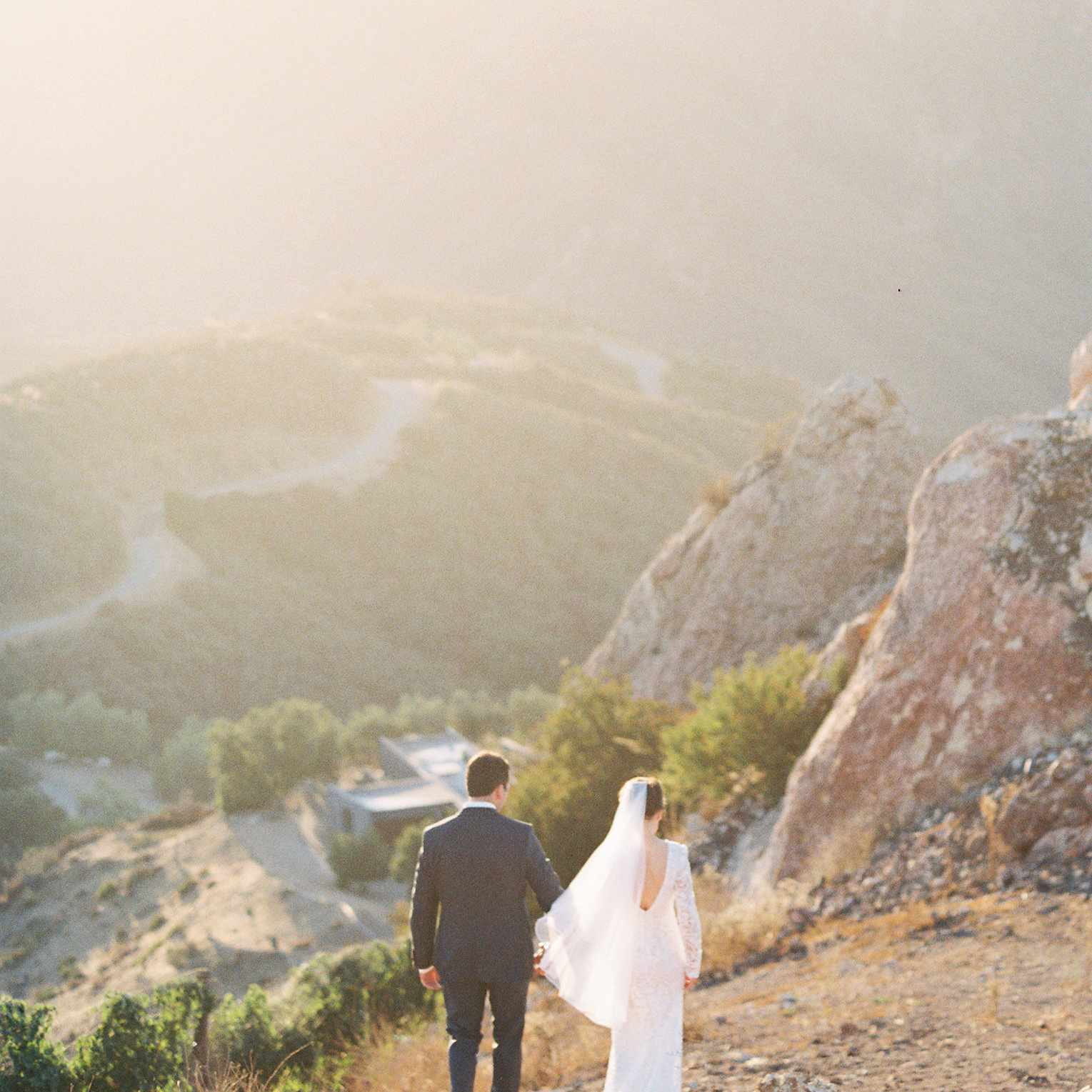 Bride and groom on mountain