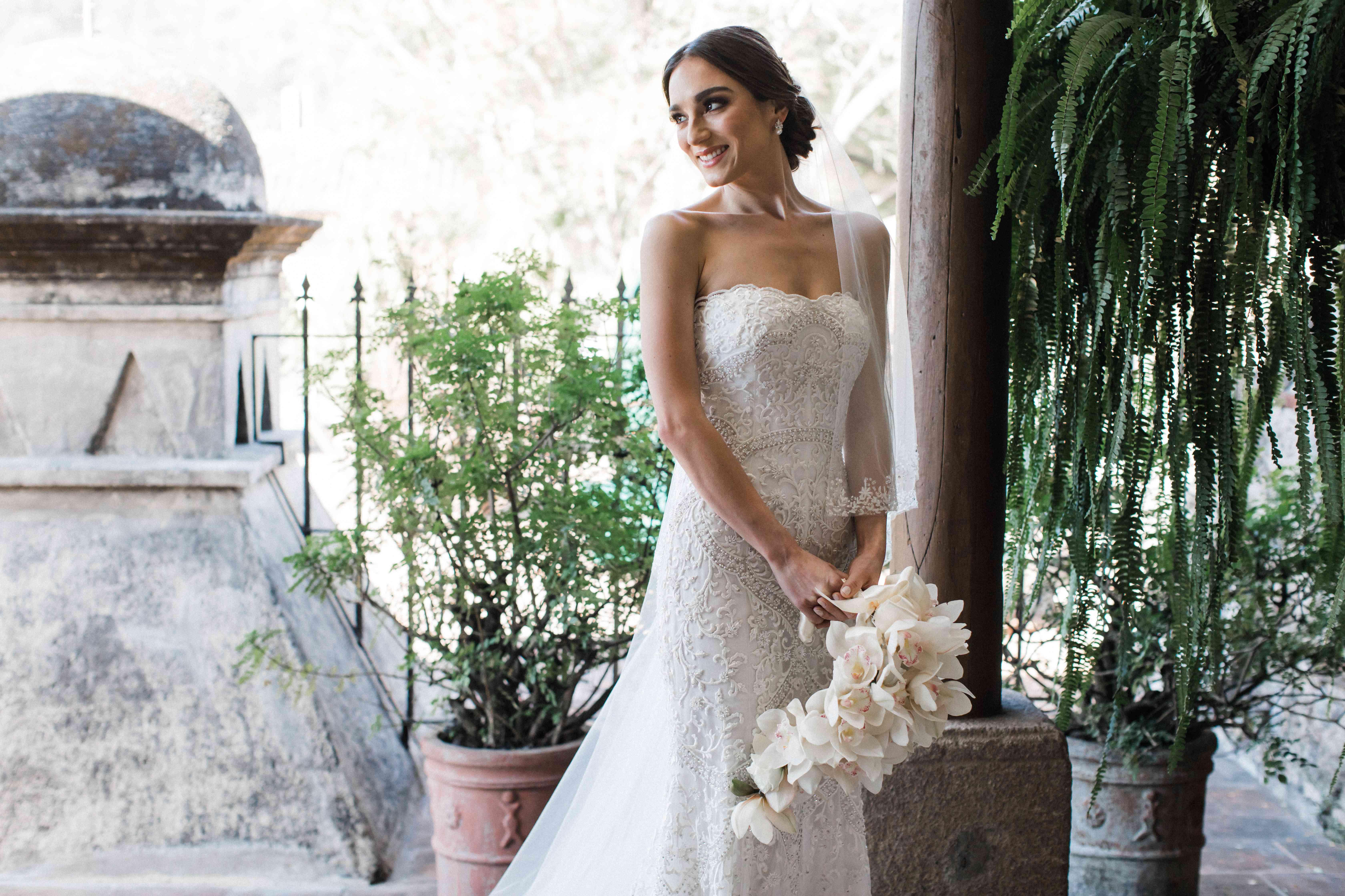 Bride holding orchid bouquet