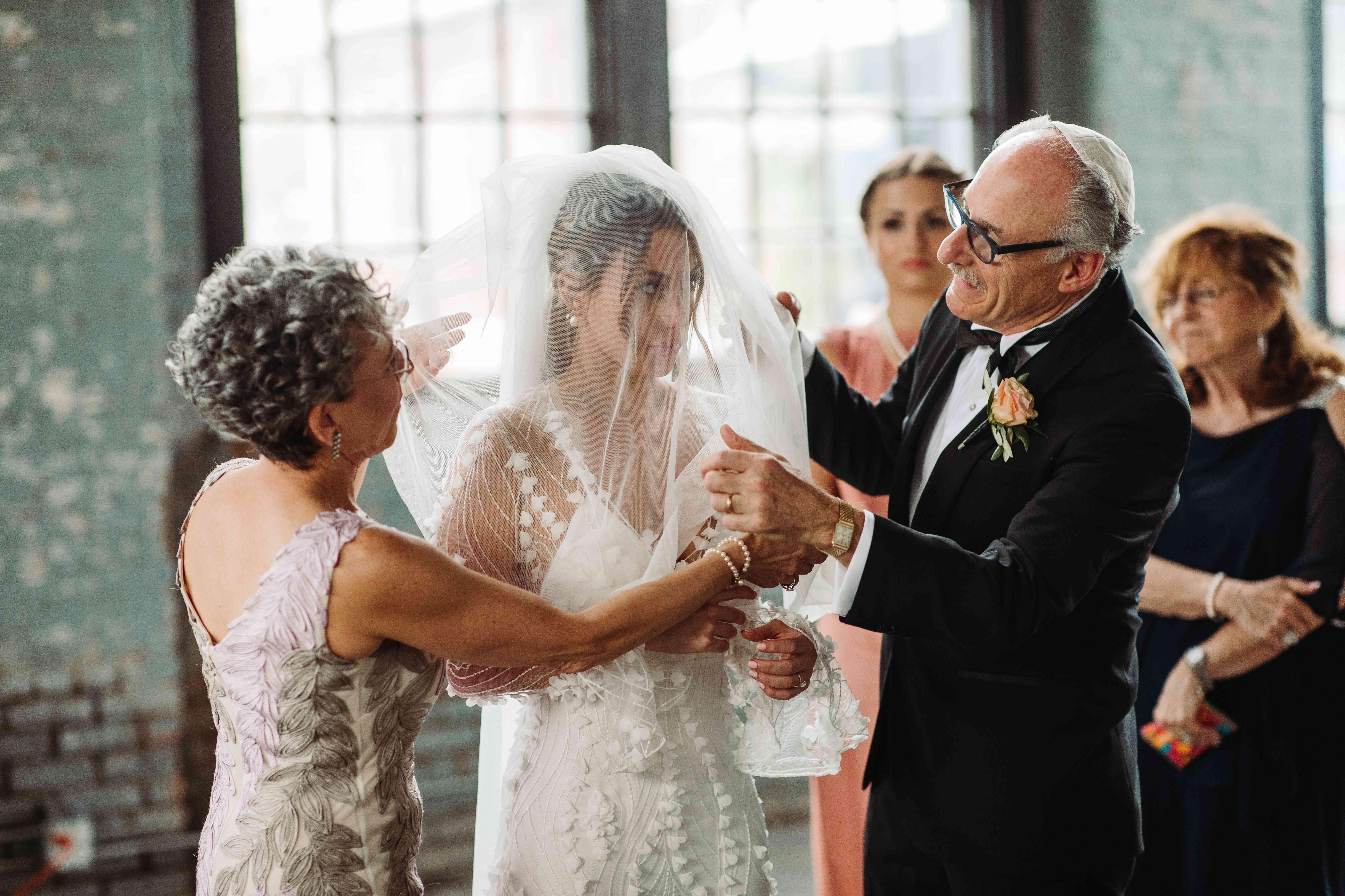 bride's parents fixing veil