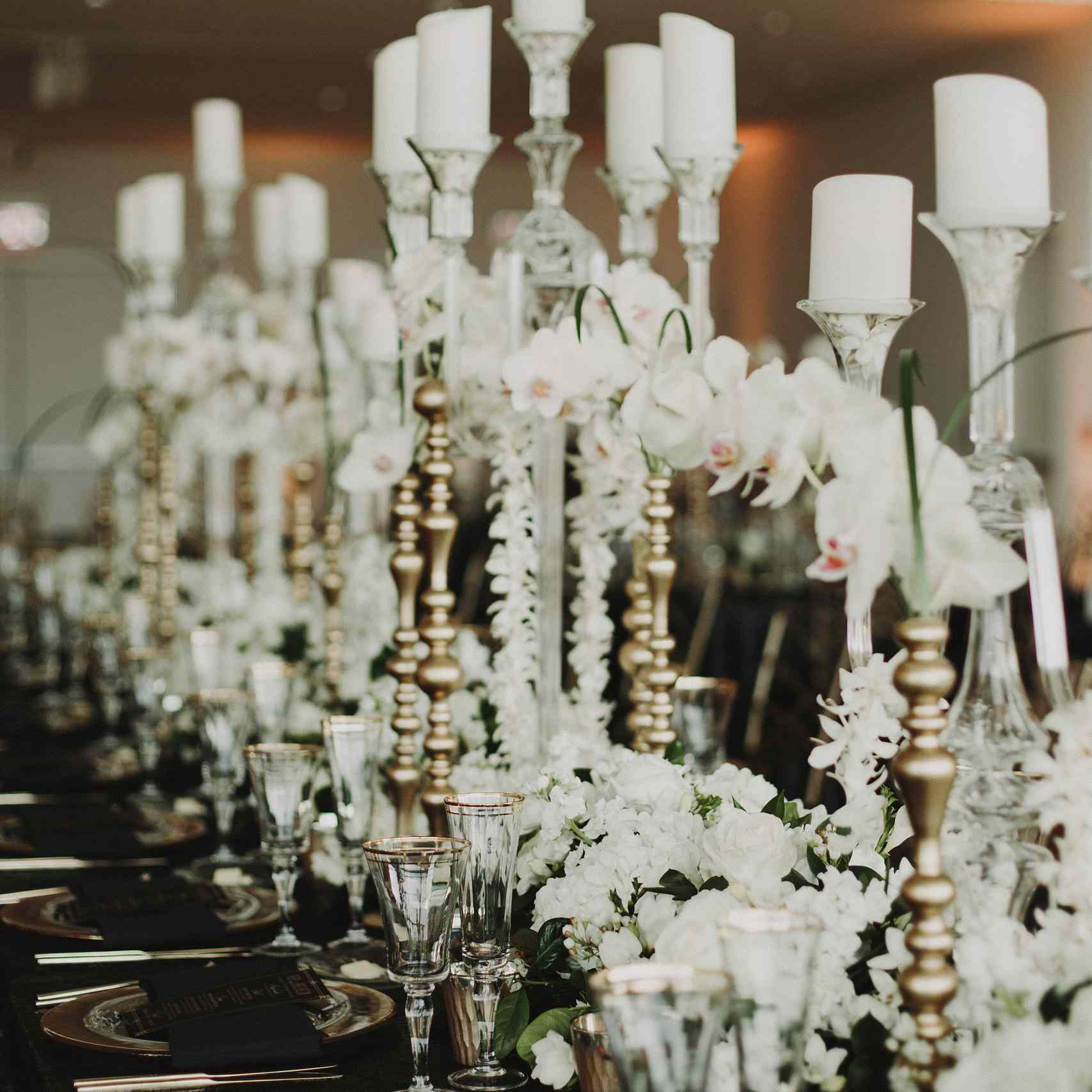 Black and gold tablescape with high candles