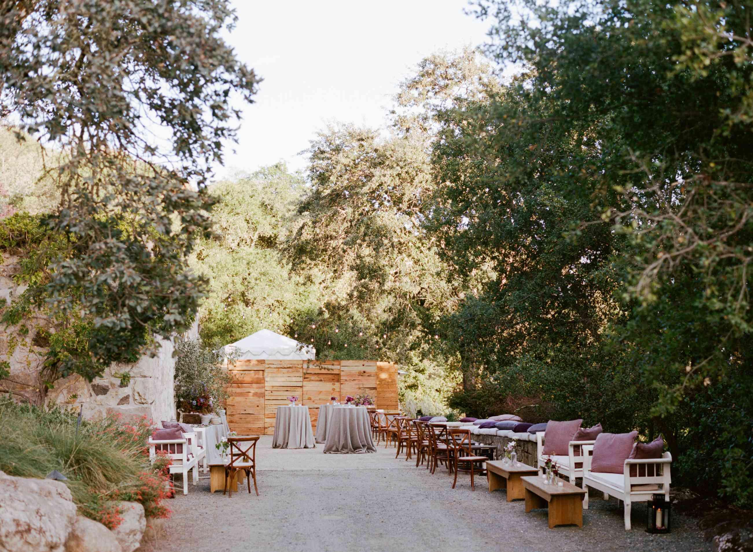 <p>Lounge area amongst trees and foliage.</p>