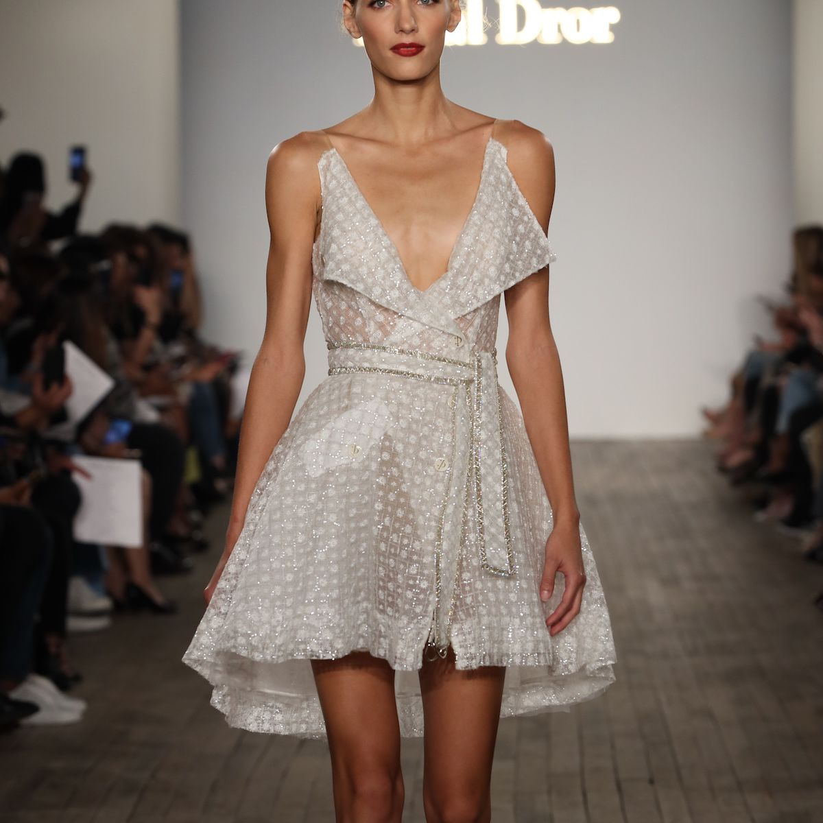 Model in mini wedding dress with lapels