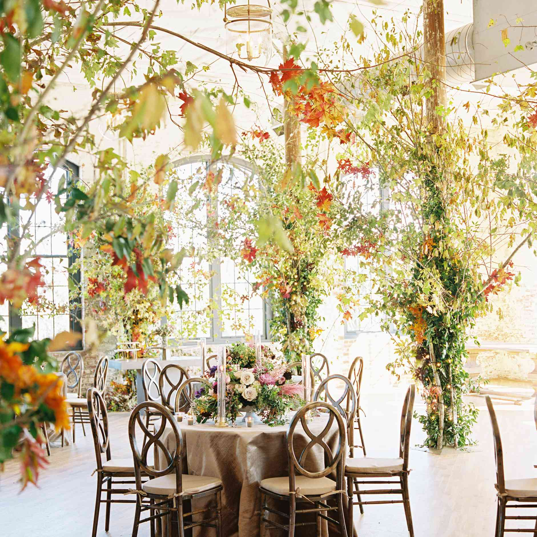 Autumnal greenery, leaves, and floral reception décor