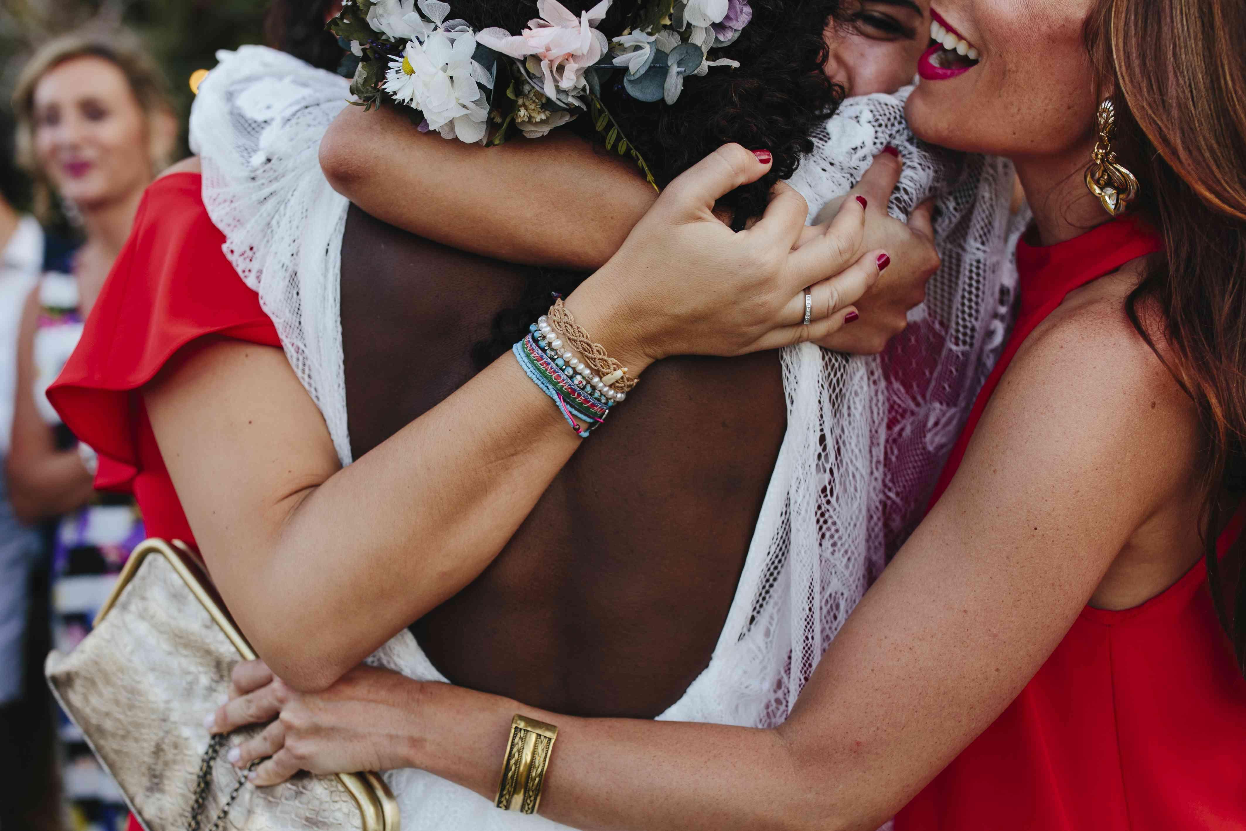 bride hugging friends