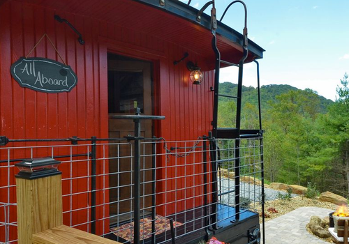 Converted train tiny house overlooking the woods of western North Carolina