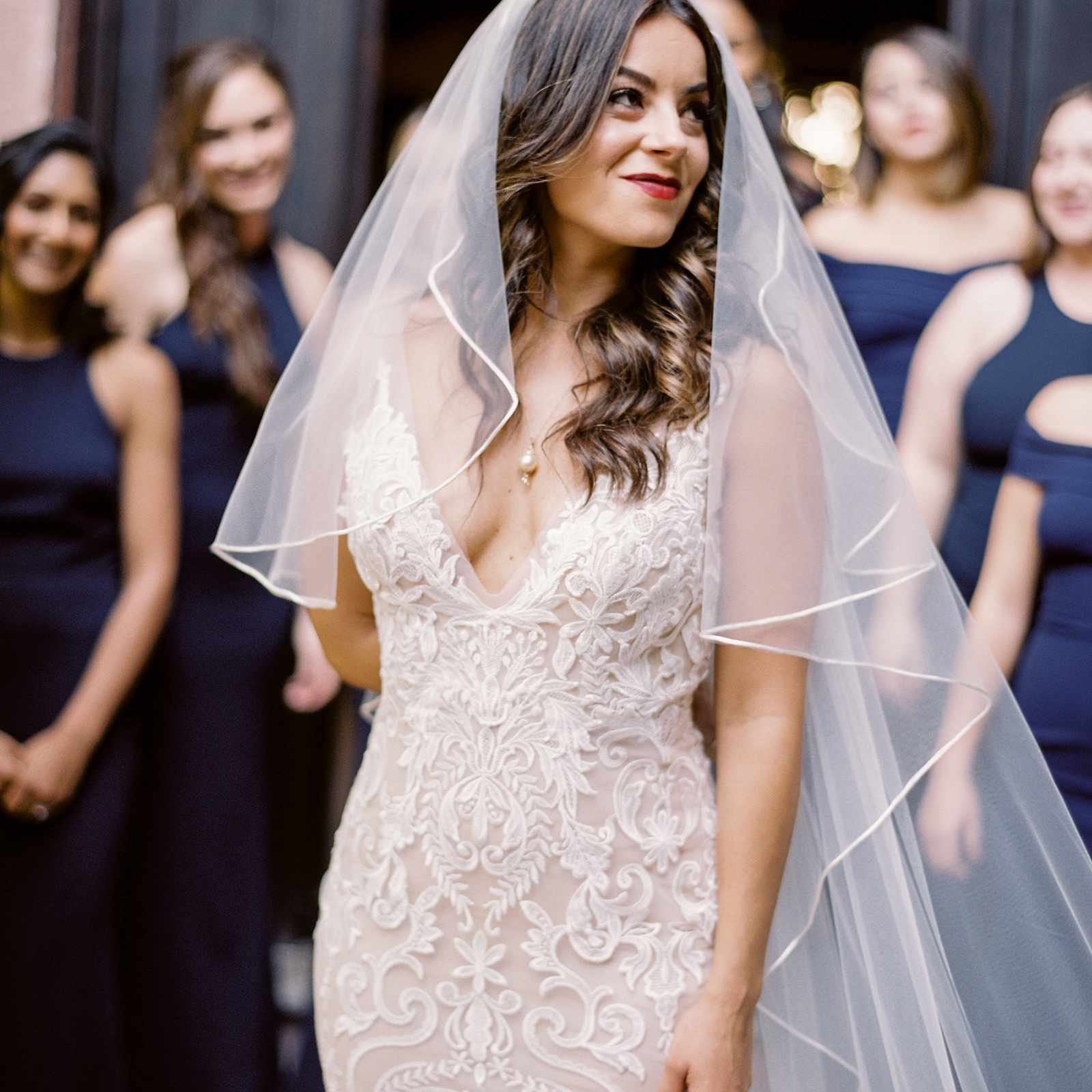 Bride in tiered veil and intricate dress