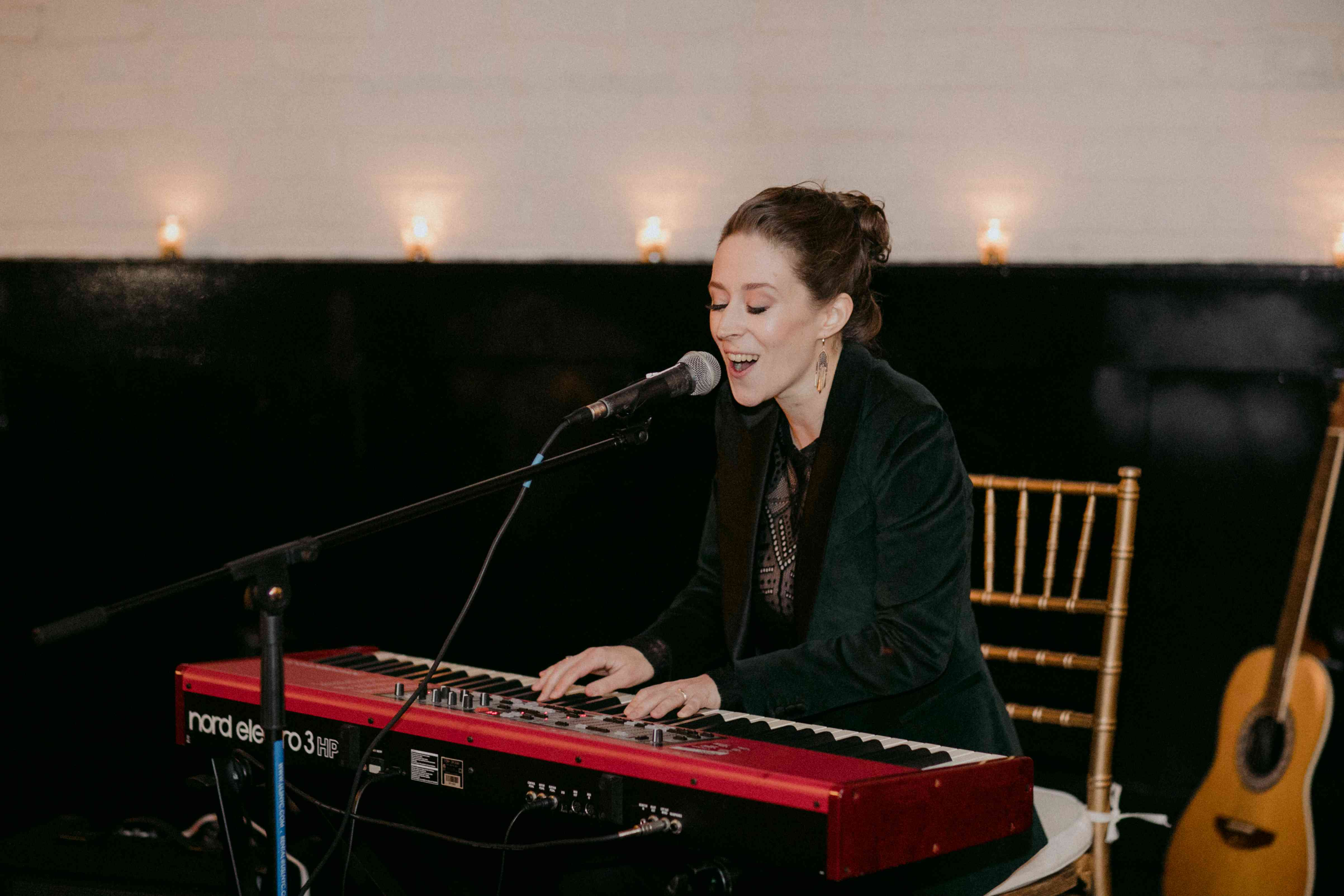 Katie performs a song on the keyboard