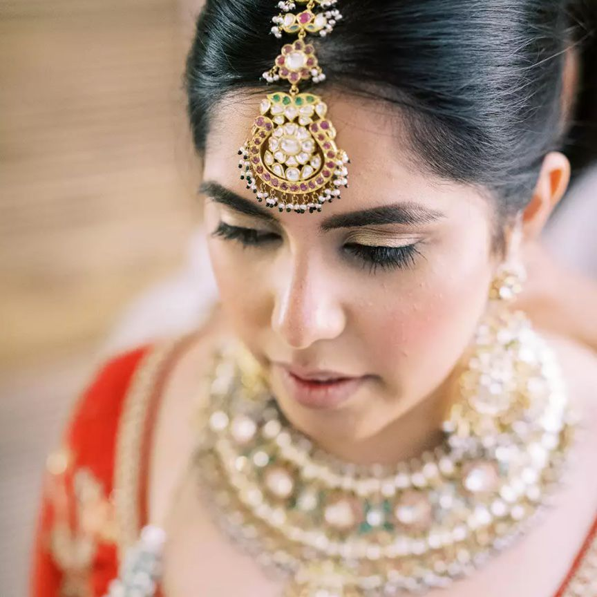 bride wearing traditional indian wedding gown and jewelry