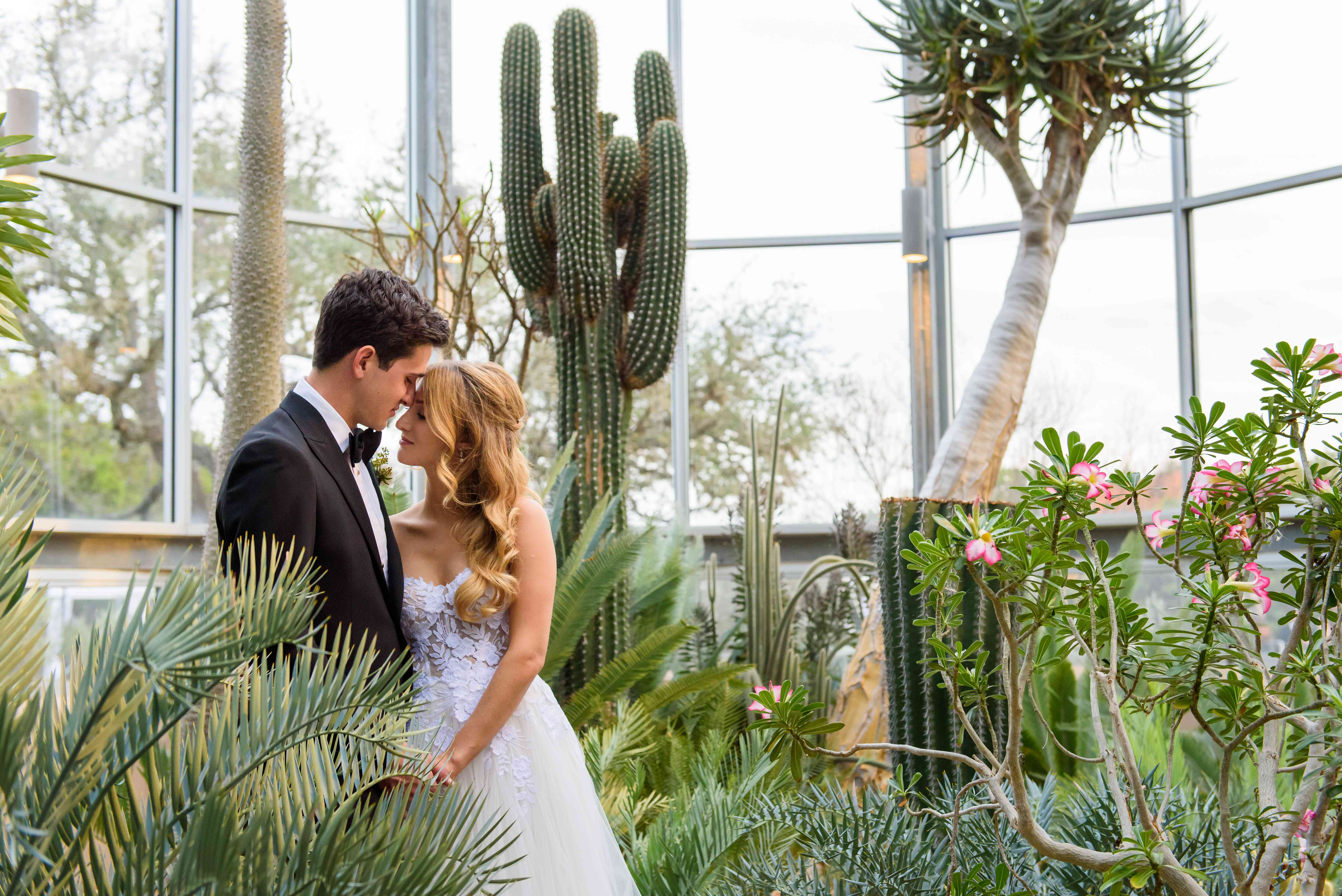 Couple hugging in their wedding photos at The Greenhouse at Driftwood in Texas