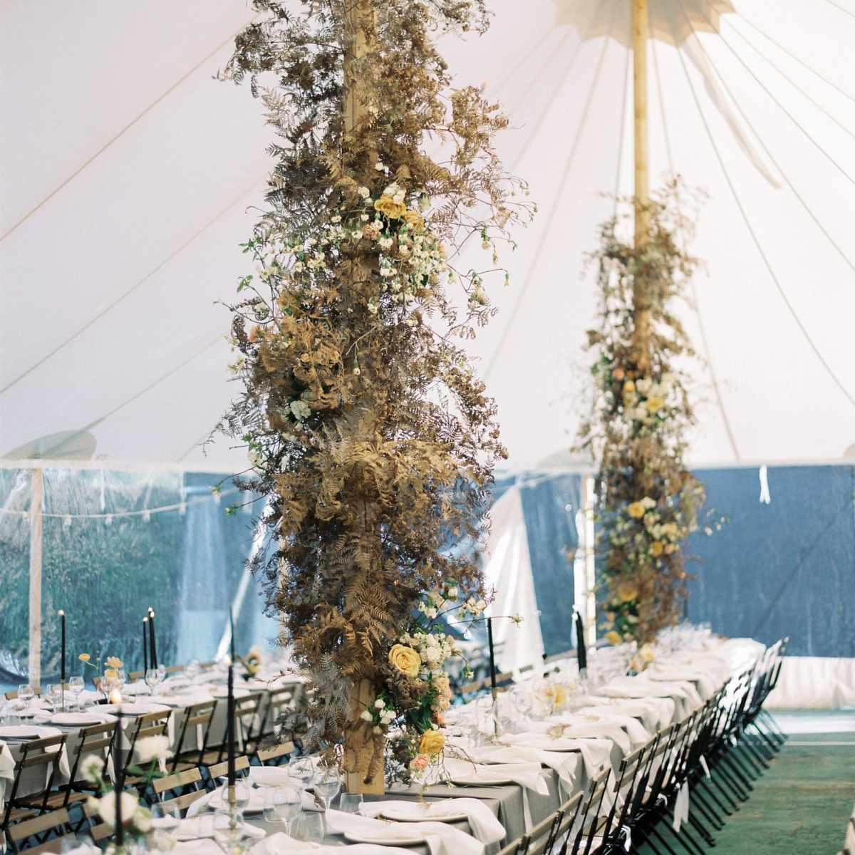 Flower-wrapped tent poles
