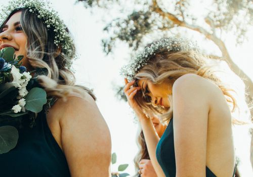two bridesmaids with flower crowns
