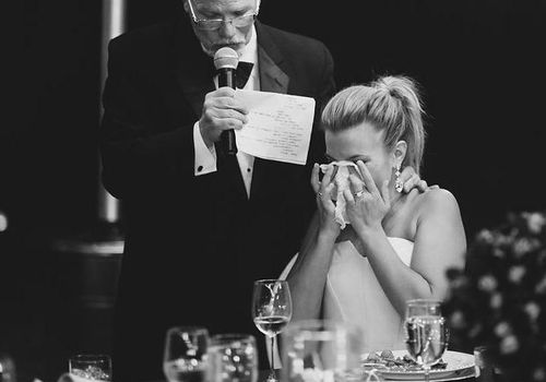 bride crying while father of the bride gives speech
