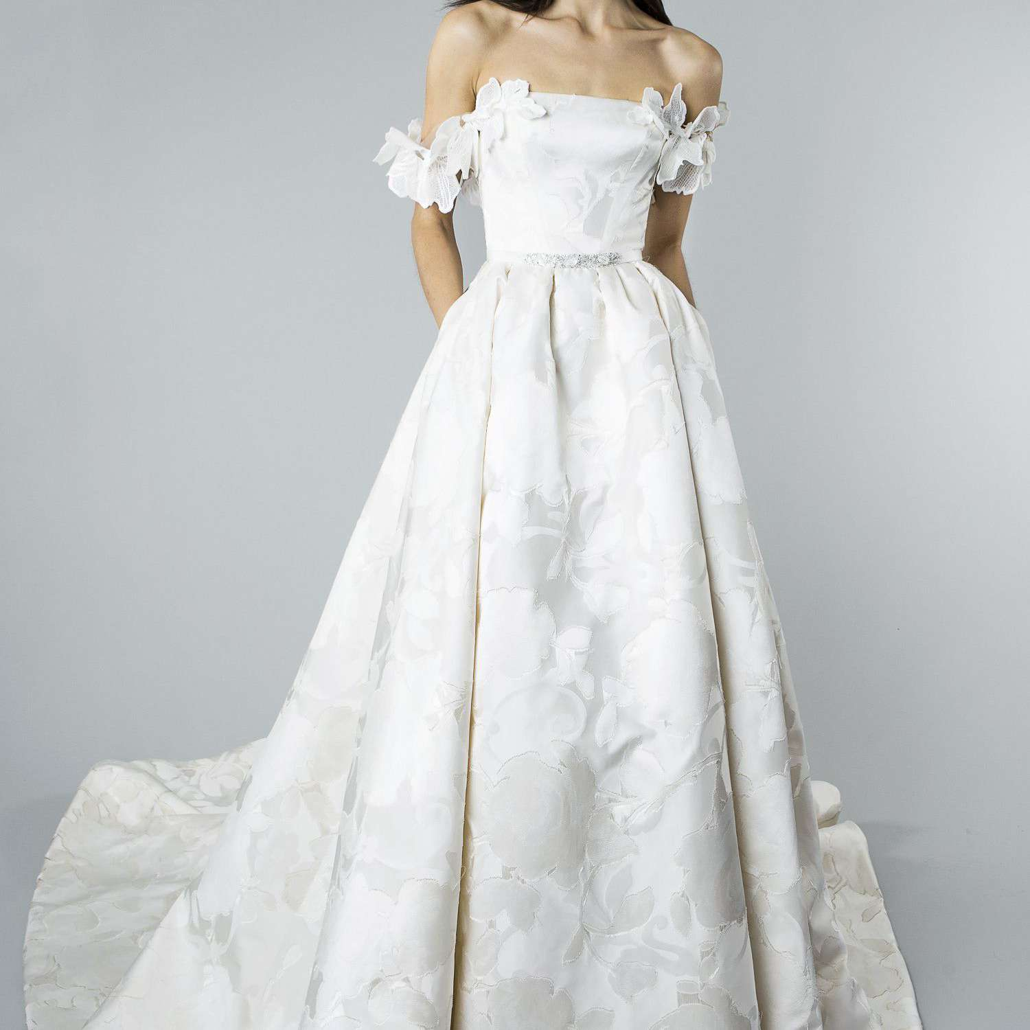 Model in Ivory Silk Fils Coupe Rose Motif Ballgown with Floral Drape Cap Sleeve