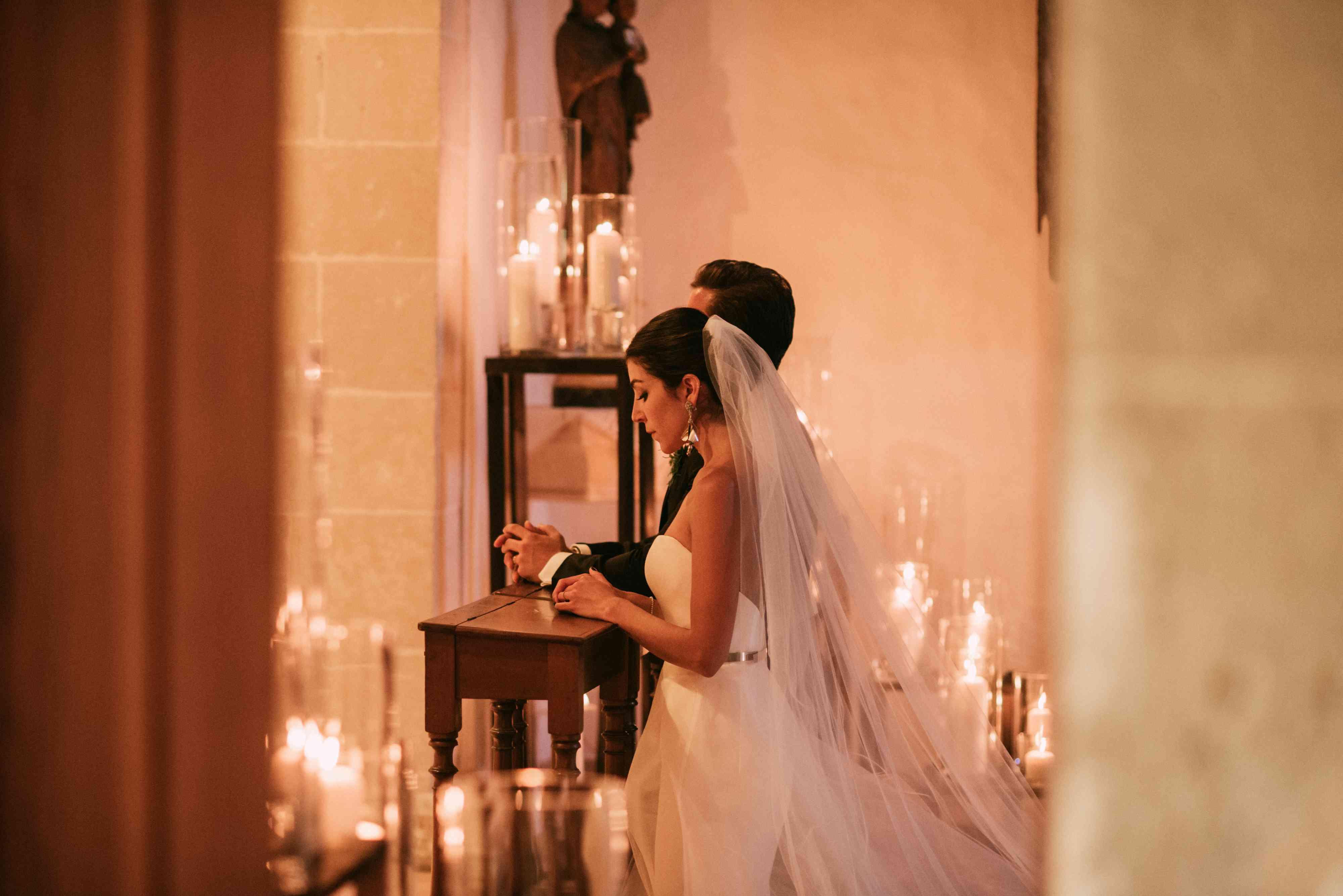 roman catholic ceremony couple praying
