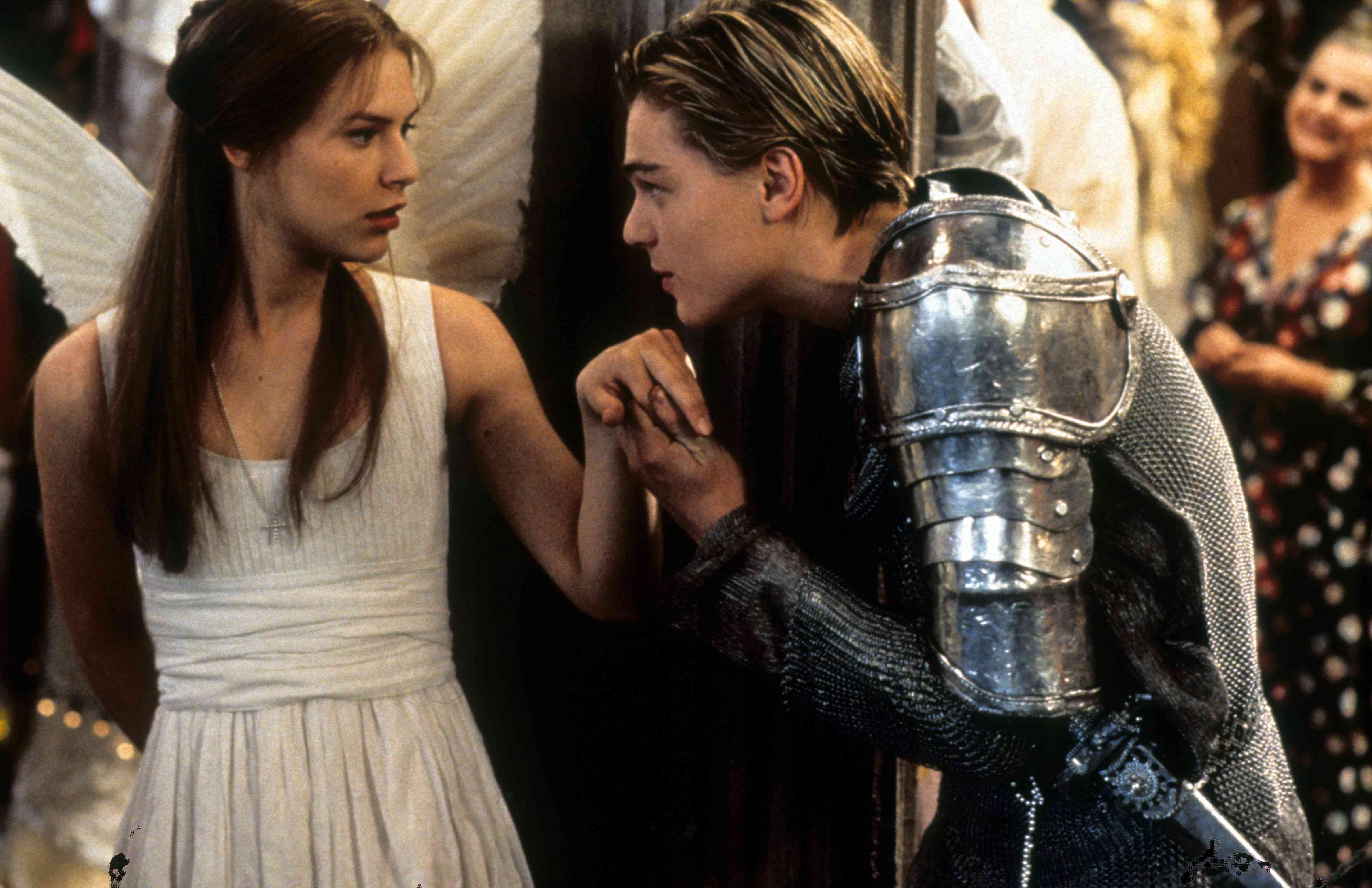 Claire Danes is surprised as Leonardo DiCaprio takes her hand to kiss in scene from the film 'Romeo + Juliet', 1996