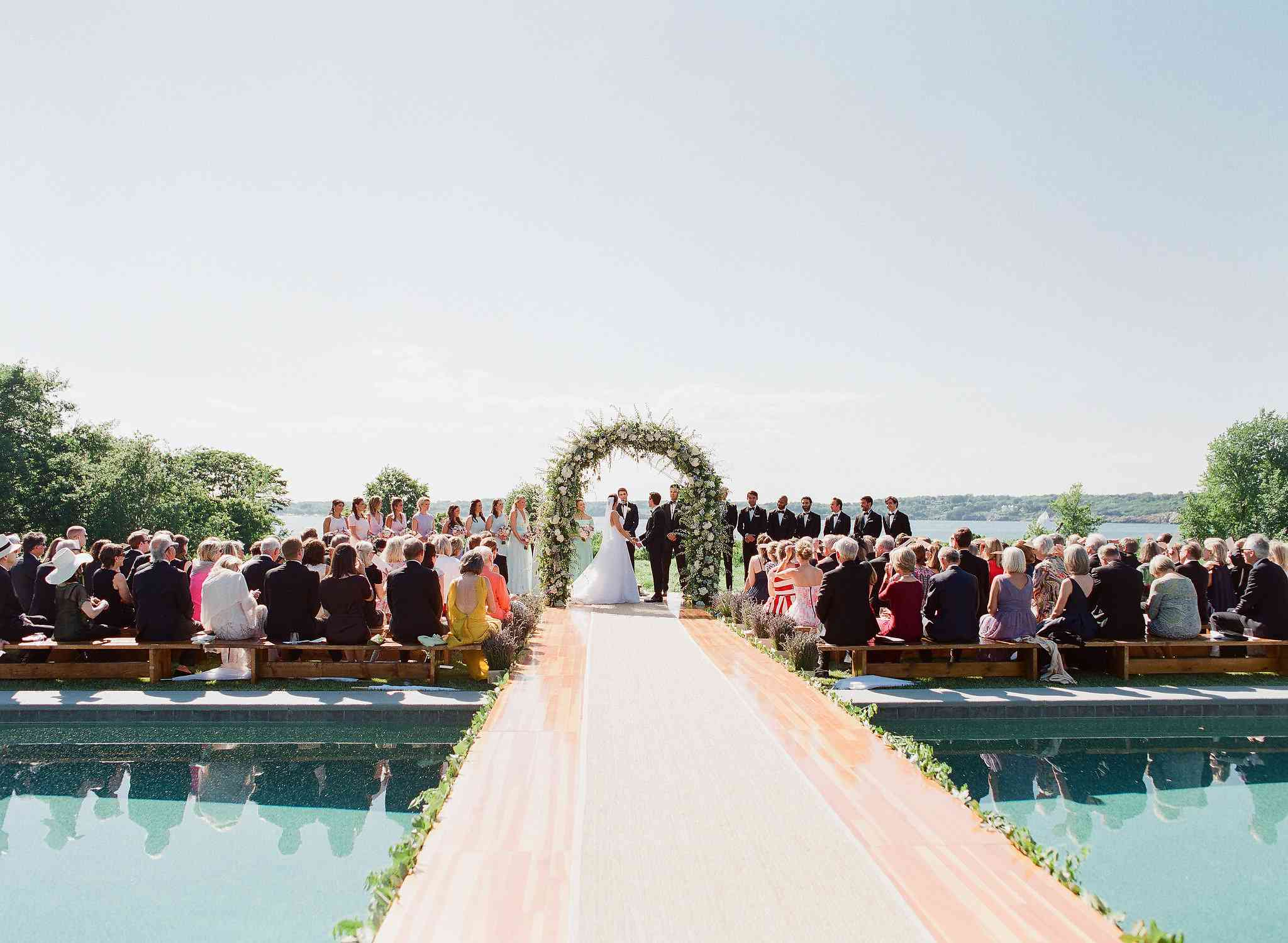Wedding aisle as a bride crossing over a pool