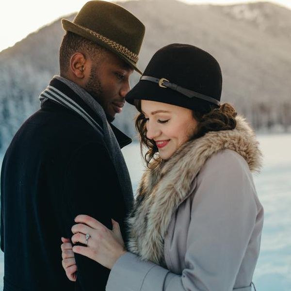 Man and woman standing close outdoors