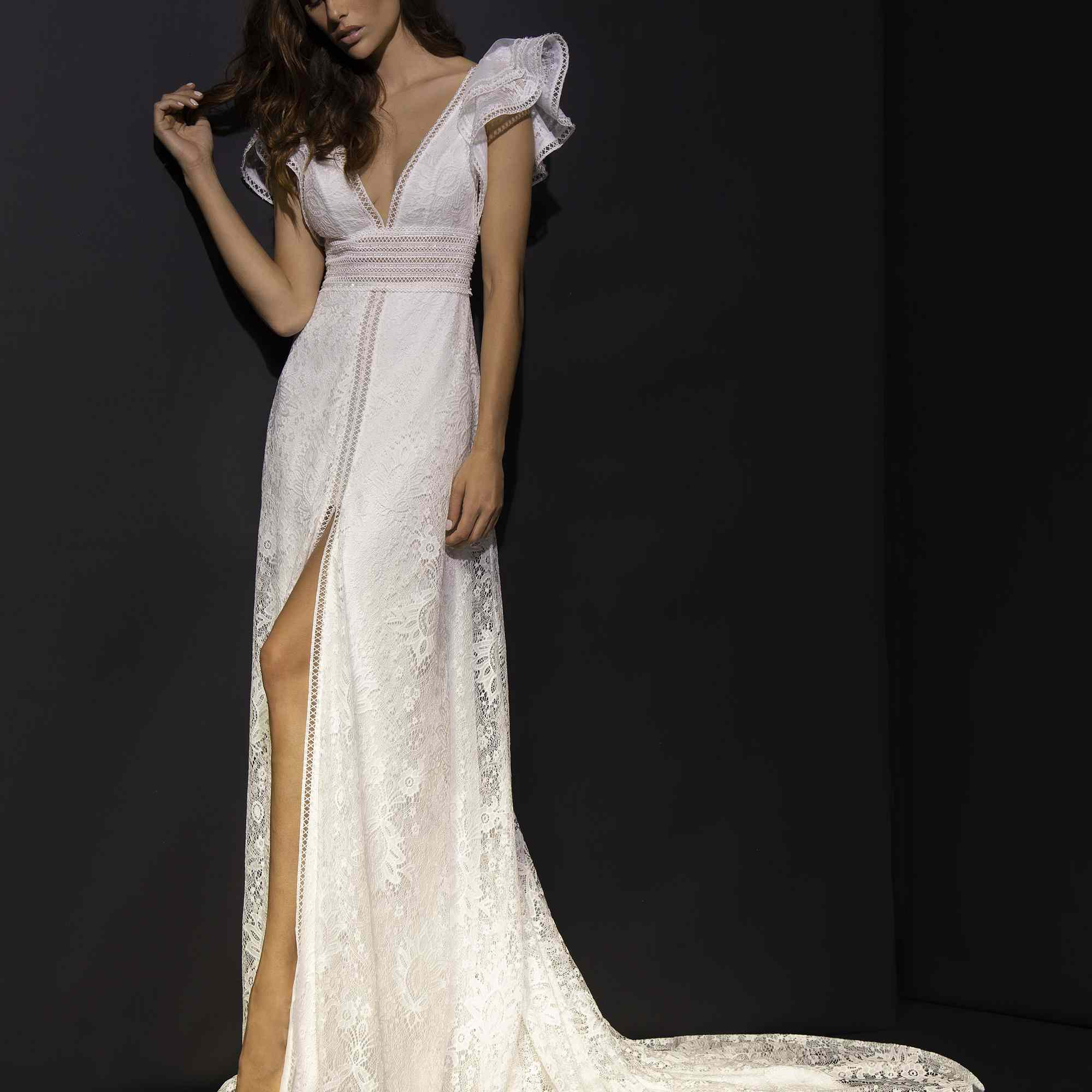 Model in V-neck gown with high skirt slit and butterfly sleeves