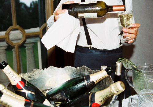 <p>bartender pouring champagne</p>