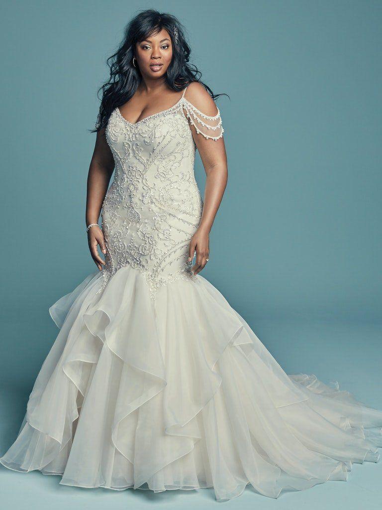 Plus size model in beaded mermaid wedding gown