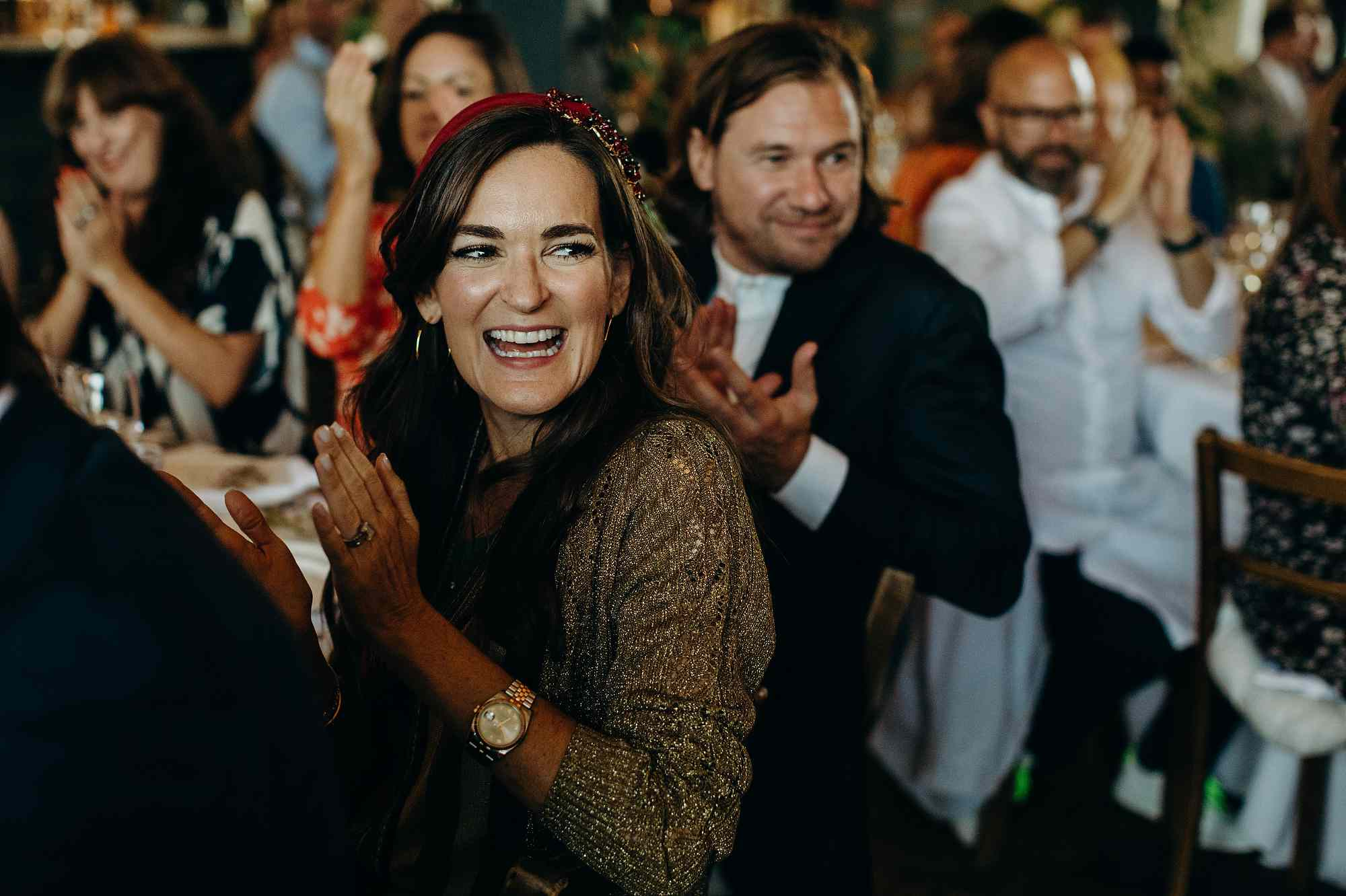 woman at a wedding clapping