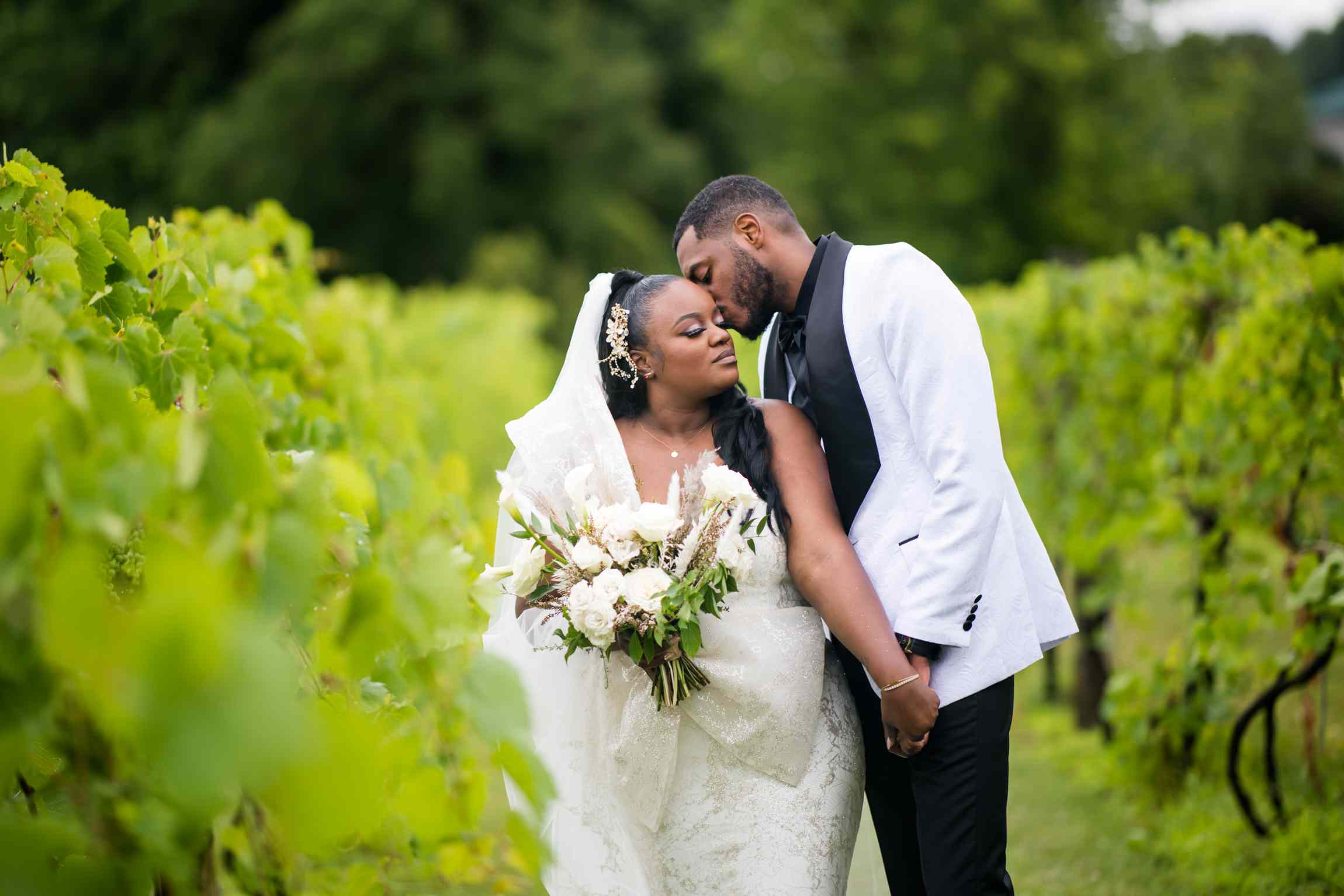 Couple shot in the vineyard
