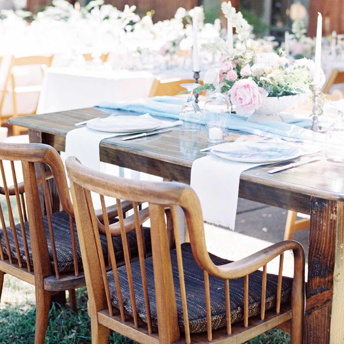 wood outdoor tables with light flowers