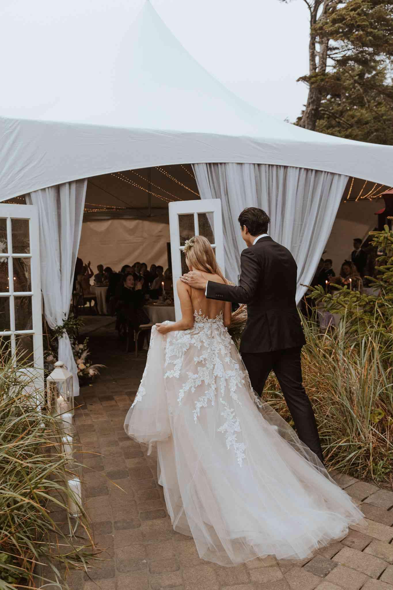 couple entering tent