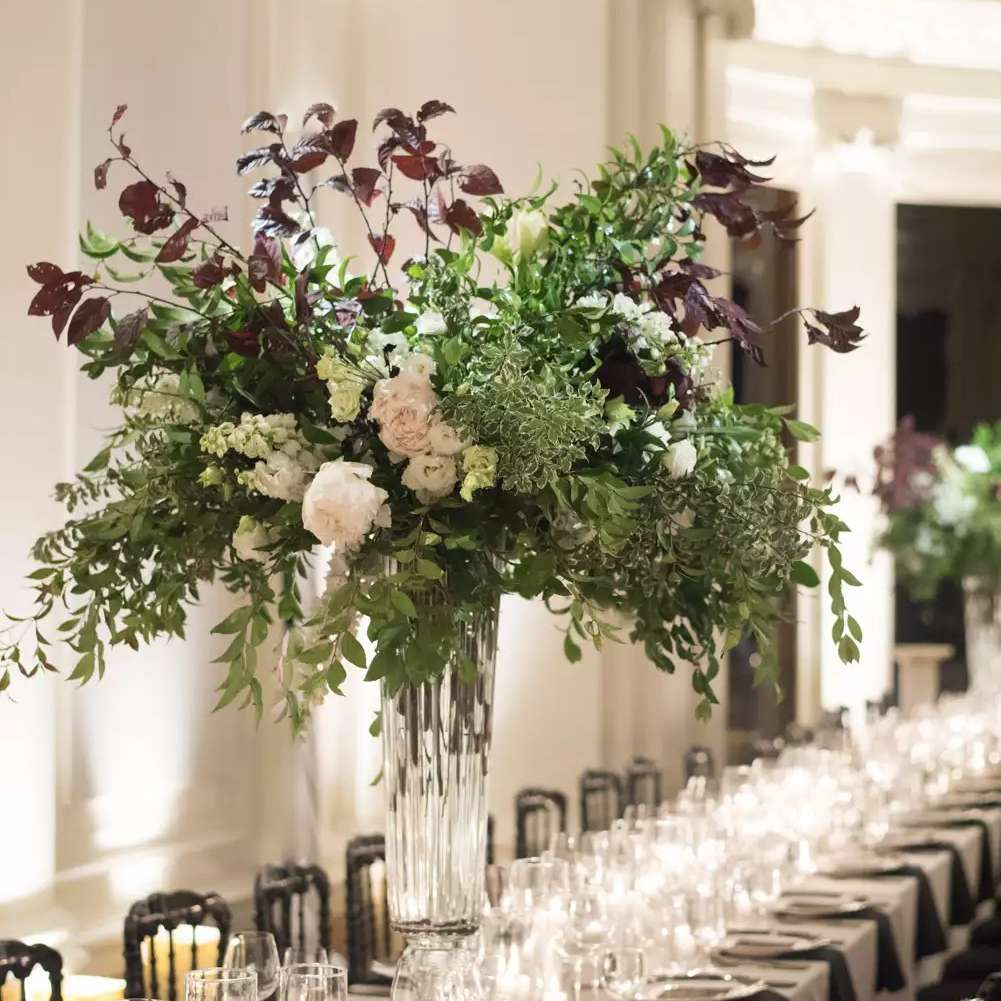 Tall Crystal Vases Displaying Lush greenery and Peonies