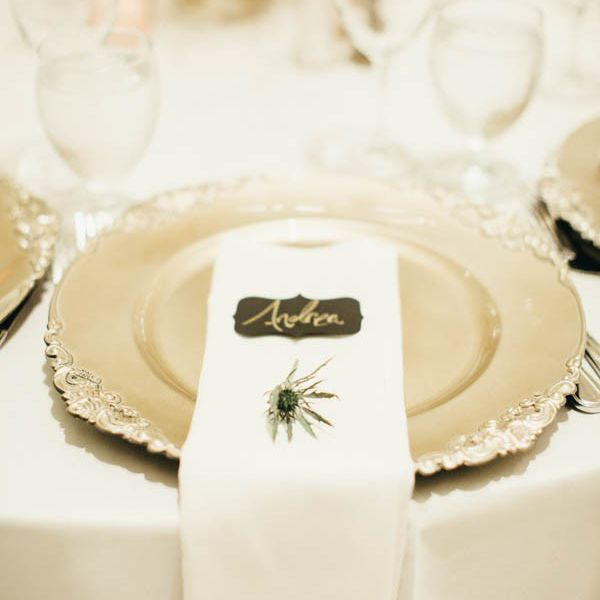 Peackock feather accented table setting