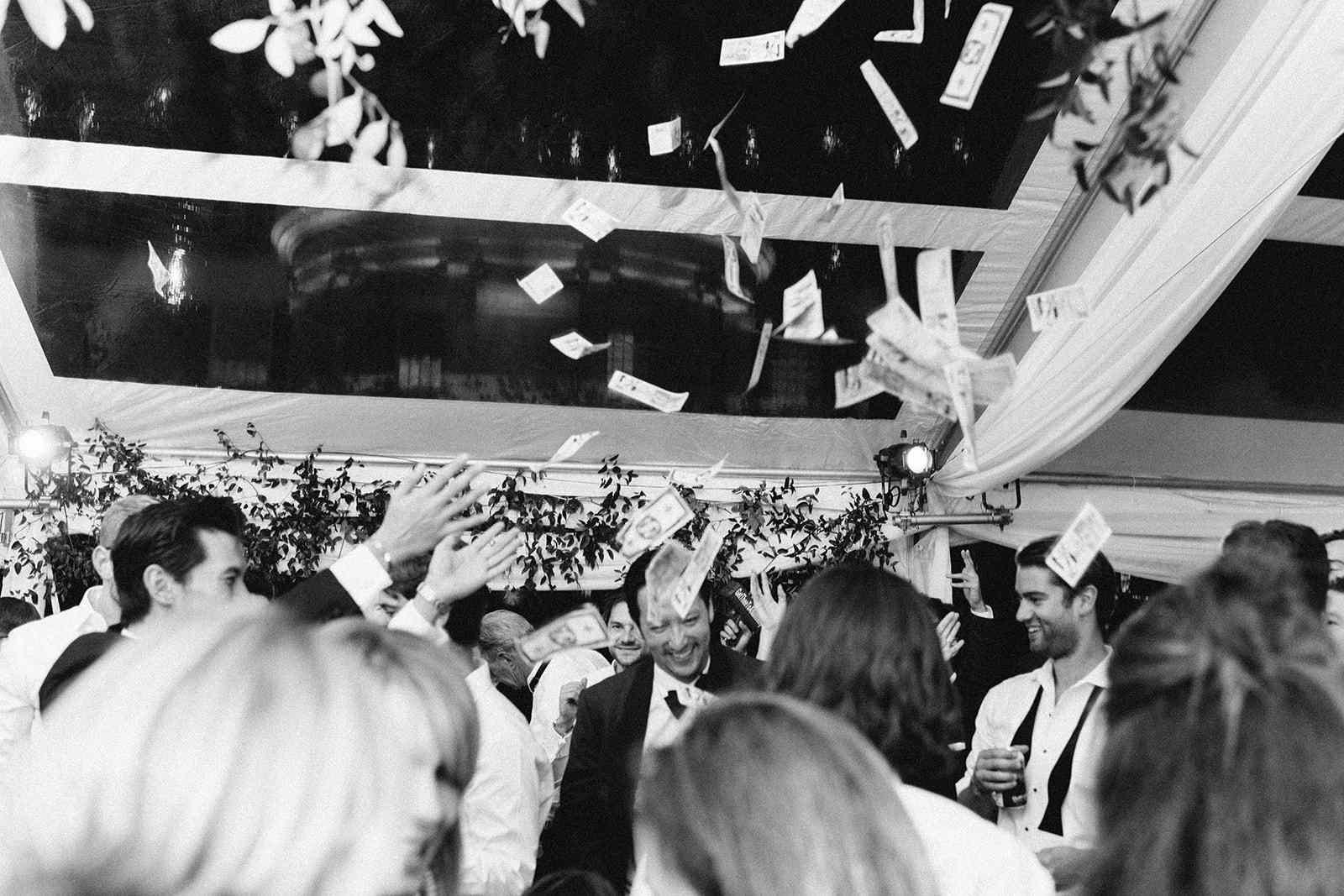 Money flying in the air over dance floor