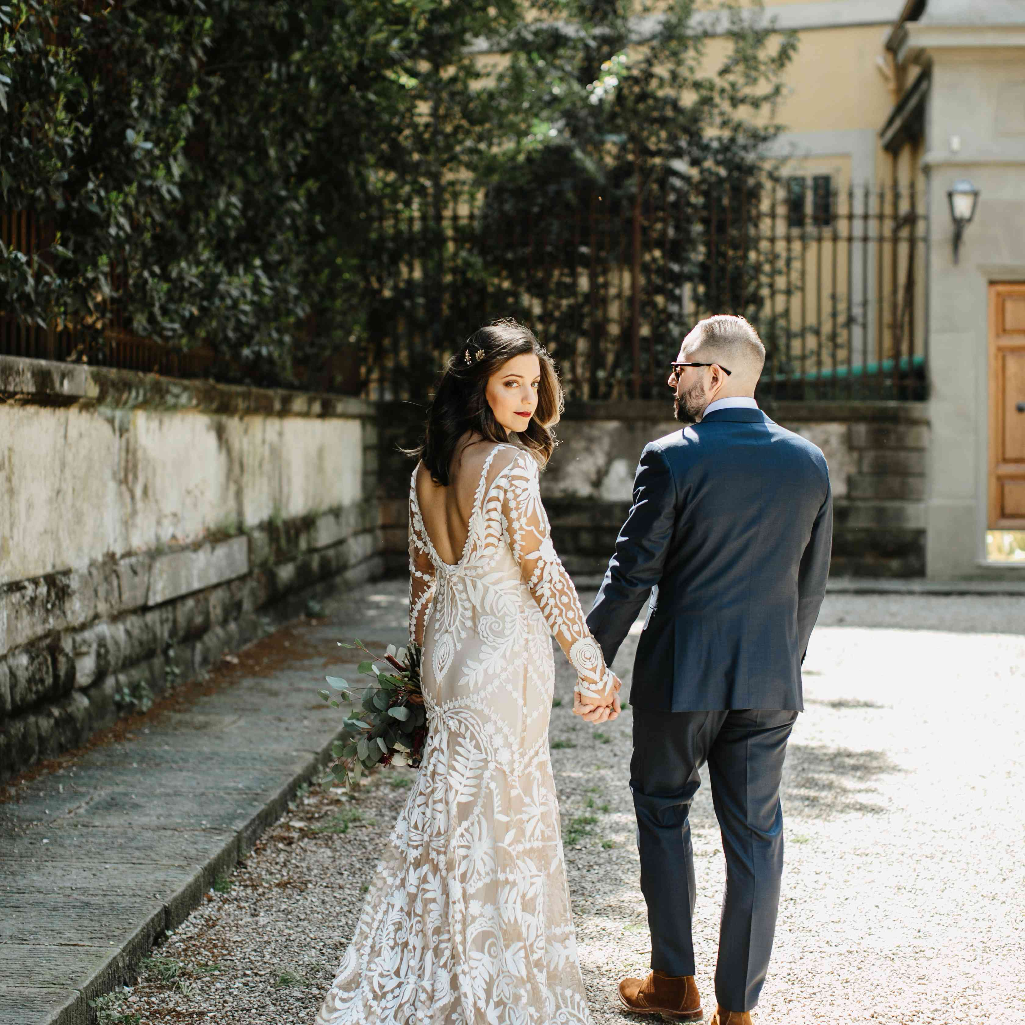 <p>bride and groom low back wedding dress</p><br><br>