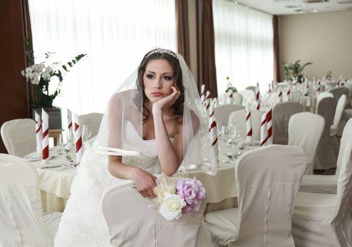 Sad bride sitting alone