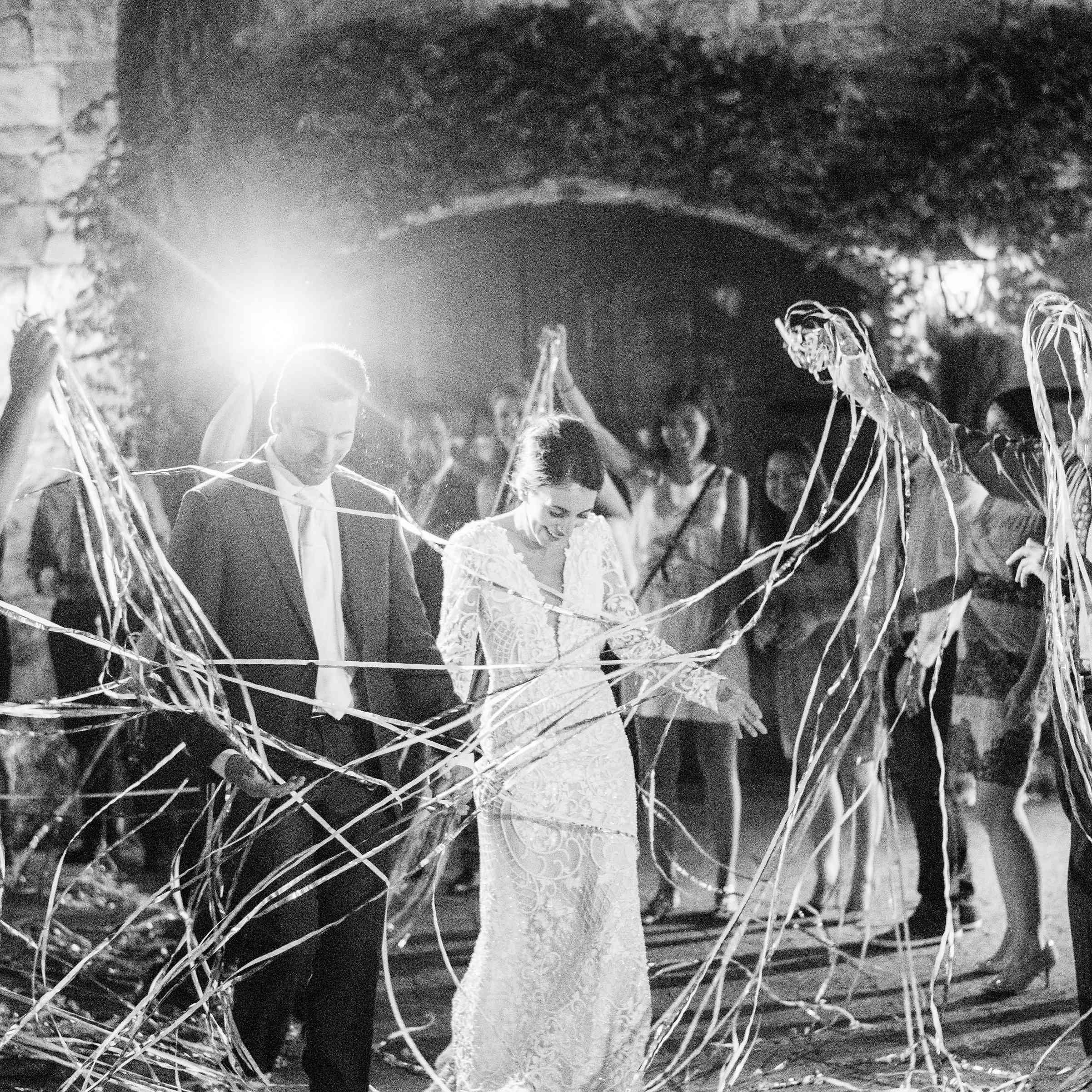 Bride and groom with streamers