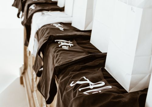 Gift bags lined up on bachelorette swinsuits