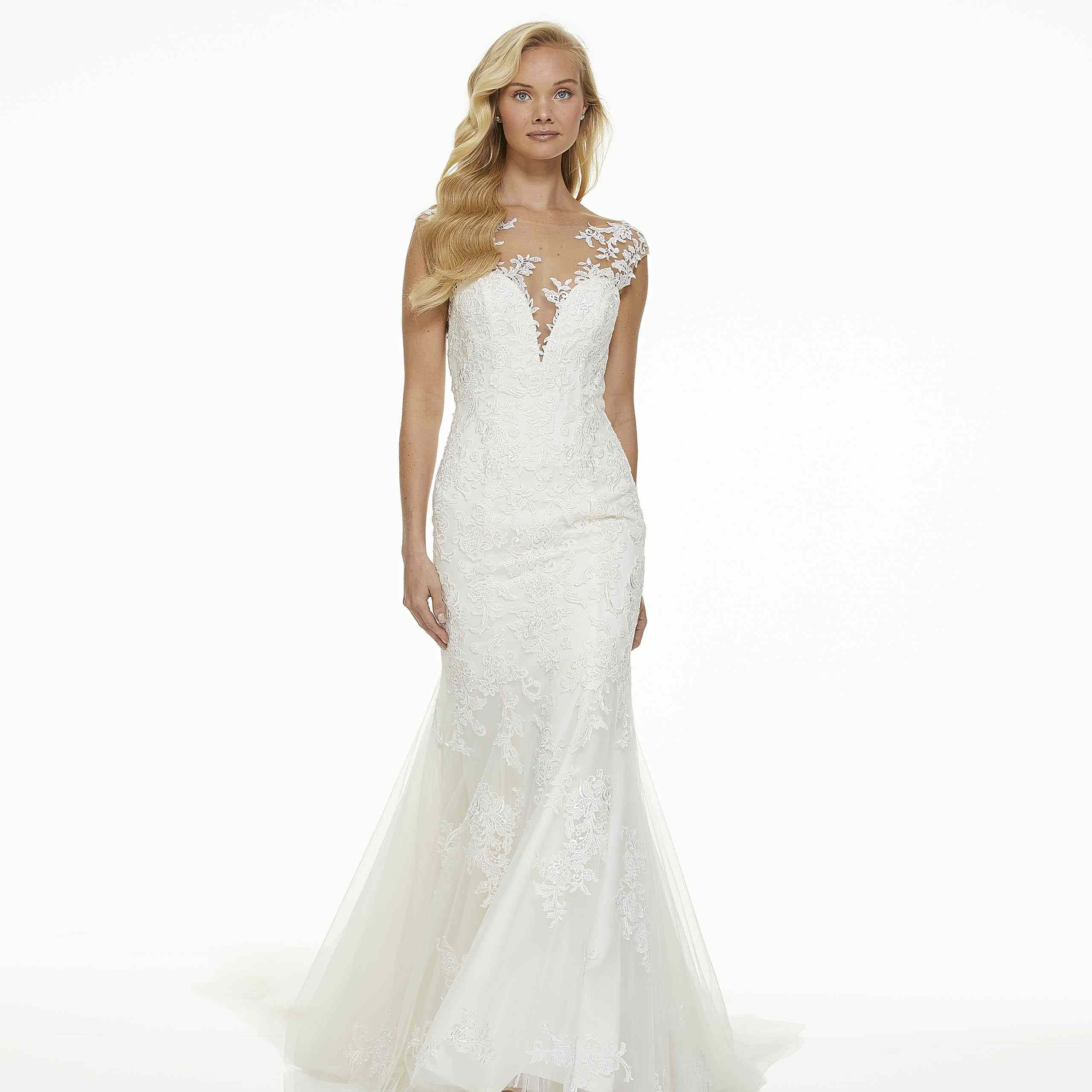 Model in fit-and-flare wedding dress
