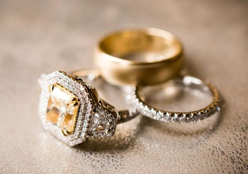 Yellow Diamond Engagement Ring with a Double Halo